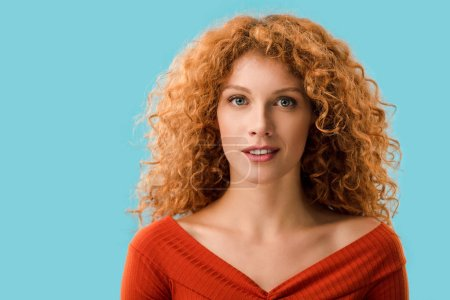 Photo for Portrait of attractive redhead girl isolated on blue - Royalty Free Image