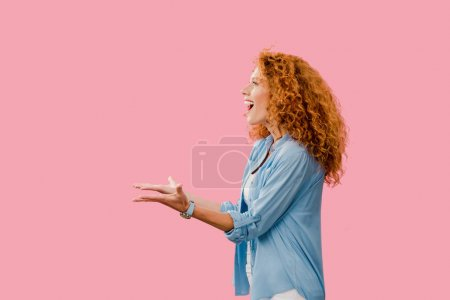 Photo for Happy redhead woman gesturing Isolated On pink - Royalty Free Image