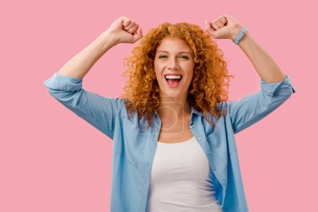 Photo for Excited redhead woman gesturing Isolated On pink - Royalty Free Image