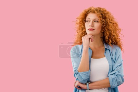 Photo for Attractive thoughtful young woman isolated on pink - Royalty Free Image