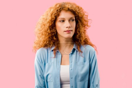 Photo for Attractive serious redhead girl isolated on pink - Royalty Free Image