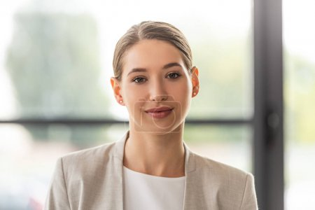 Photo for Front view of attractive businesswoman looking at camera with gently smile - Royalty Free Image