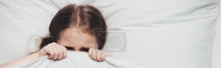 Photo for Panoramic shot of scared child hiding under blanket - Royalty Free Image
