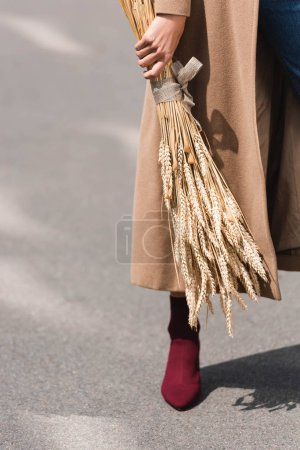 Photo for Cropped view of young adult woman holding spikes outside - Royalty Free Image
