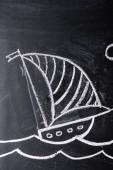 """Постер, картина, фотообои """"корабль с полосатым парусом рисунок на доске"""""""