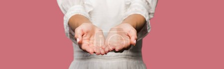 Photo for Panoramic shot of young woman with cupped hands isolated on pink - Royalty Free Image