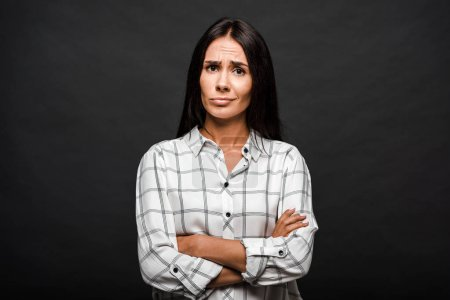 Photo for Displeased woman standing with crossed arms isolated on black - Royalty Free Image