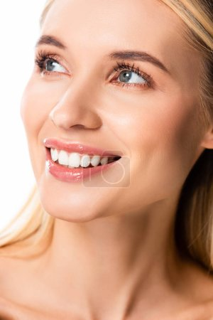 naked smiling blonde woman with white teeth looking away isolated on white