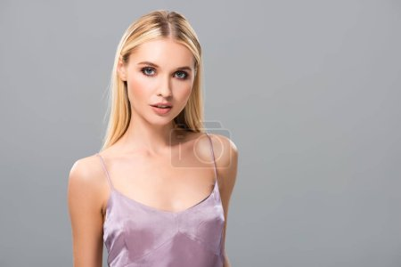 Photo for Elegant blonde girl in violet satin dress isolated on grey - Royalty Free Image