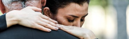 Photo for Panoramic shot of woman hugging senior man - Royalty Free Image