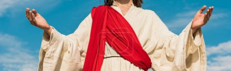 Photo for Panoramic shot of jesus with outstretched hands against blue sky - Royalty Free Image