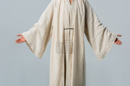 Photo for Cropped view of man in jesus robe with outstretched hands isolated on grey - Royalty Free Image