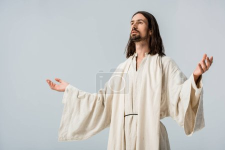 Photo for Man in jesus robe with outstretched hands isolated on grey - Royalty Free Image