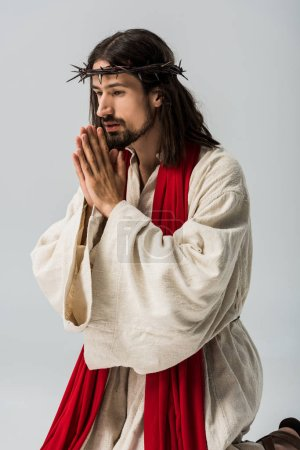 Photo for Religious man with praying hands and jesus robe isolated on grey - Royalty Free Image