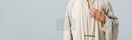 Photo for Panoramic shot of man with hand on chest isolated on grey - Royalty Free Image