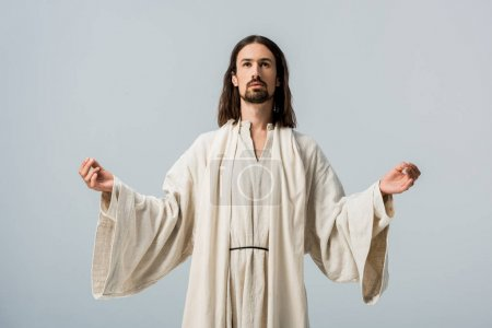 Photo for Religious man in jesus robe with outstretched hands isolated on grey - Royalty Free Image