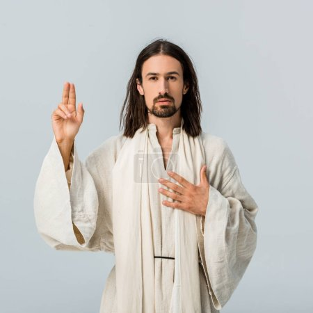 Photo for Handsome man praying with hand on chest isolated on grey - Royalty Free Image