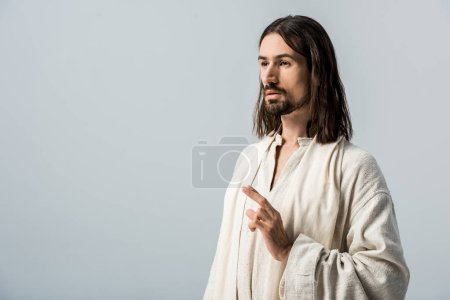 Photo for Bearded man with belief gesturing isolated on grey - Royalty Free Image