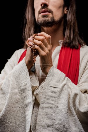 Photo for Cropped view of religious man holding rosary beads isolated on grey - Royalty Free Image