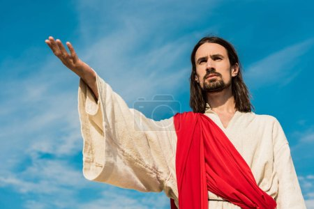 Photo for Low angle view of jesus with outstretched hand - Royalty Free Image