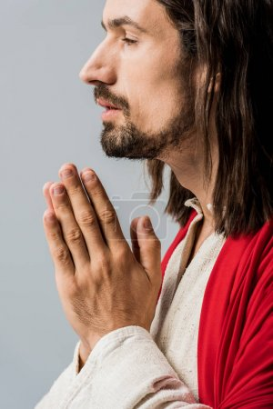 Photo for Side view of bearded man with praying hands isolated on grey - Royalty Free Image