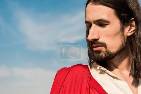 Photo for Bearded religious man against blue sky and clouds - Royalty Free Image