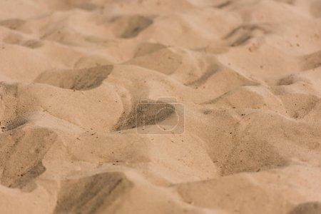 selective focus of golden wavy sand in desert