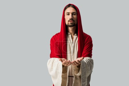 Photo for Religious man with cupped hands looking at camera isolated on grey - Royalty Free Image