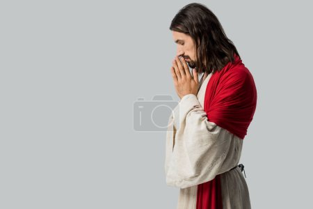 Photo for Side view of man with closed eyes praying isolated on grey - Royalty Free Image