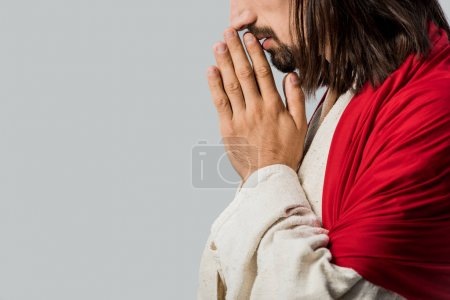 Photo for Side view of bearded man praying isolated on grey - Royalty Free Image
