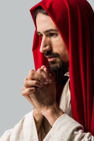 Photo pour Bel homme barbu priant isolé sur gris - image libre de droit
