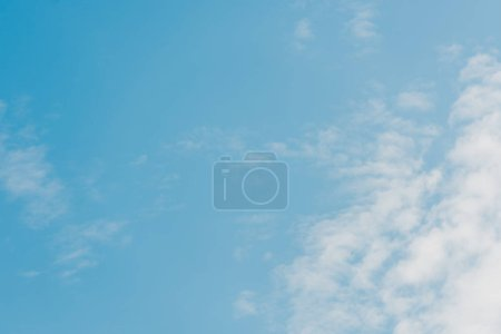 blue and clear sky with white clouds and copy space