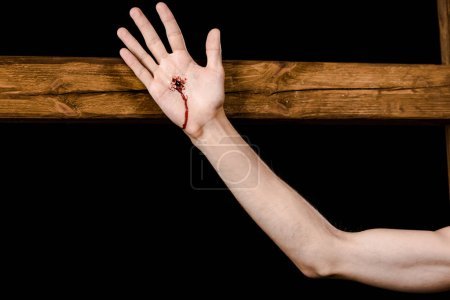 Photo for Cropped view of jesus crucified on wooden cross isolated on black - Royalty Free Image