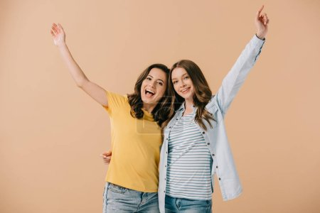 Photo for Attractive and smiling friends with outstretched hands looking at camera isolated on beige - Royalty Free Image