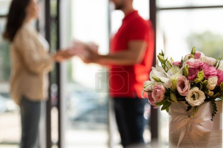 Photo for Selective focus of eustoma flowers near man and woman - Royalty Free Image