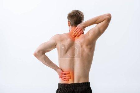 Photo pour Vue arrière du sportif torse nu avec la douleur de cou et le mal de dos d'isolement sur le gris - image libre de droit