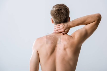Photo for Back view of shirtless man with neck pain isolated on grey - Royalty Free Image