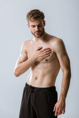 Photo for Shirtless bearded man with chest pain isolated on grey - Royalty Free Image
