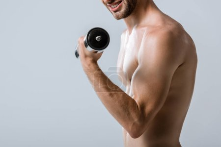 Photo for Partial view of shirtless sportsman using barbell isolated on grey - Royalty Free Image