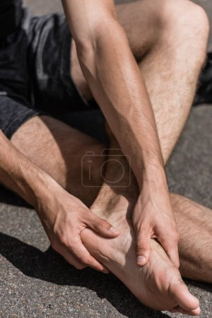Photo for Partial view of barefoot sportsman with foot pain on street - Royalty Free Image