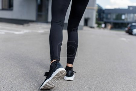 Photo for Cropped view of sportswoman in black sneakers on street - Royalty Free Image