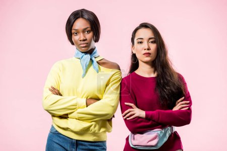 Photo for Attractive asian and african american friends with crossed arms looking at camera isolated on pink - Royalty Free Image