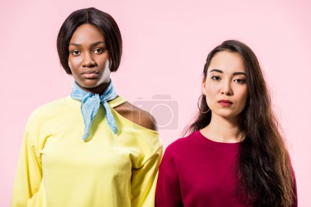 Photo for Attractive asian and african american friends looking at camera isolated on pink - Royalty Free Image