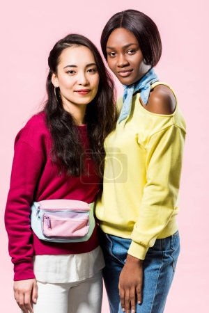 Photo for Attractive asian and african american friends smiling isolated on pink - Royalty Free Image