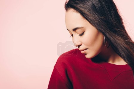 Photo for Attractive asian woman in red sweater with closed eyes isolated on pink - Royalty Free Image