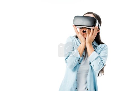 Photo for Shocked woman in denim shirt with virtual reality headset isolated on white - Royalty Free Image