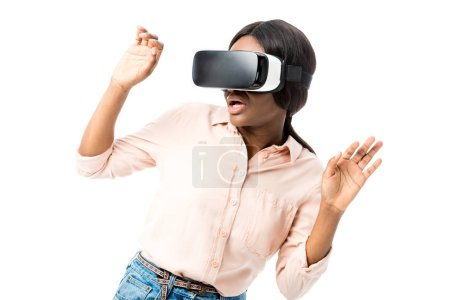 shocked african american woman in shirt with virtual reality headset isolated on white