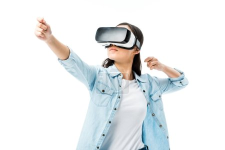 Photo for Woman in denim shirt with virtual reality headset  pulling on isolated on white - Royalty Free Image