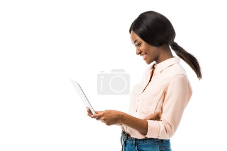 Photo for African american woman in shirt holding laptop and smiling isolated on white - Royalty Free Image
