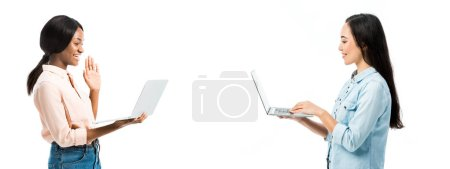 Photo for Panoramic shot of attractive asian and african american talking in video chat isolated on pink - Royalty Free Image